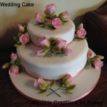 Wedding cake with pale pink sugarpaste roses